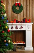 Fireplace with beautiful Christmas decorations in room