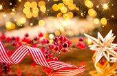 Christmas background. Traditional New Year decorations over glowing golden holiday background