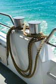 bollard with coiled rope on board ship