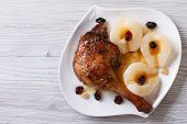 Meat Duck Leg With Pears And Raisins Closeup Top View Horizontal
