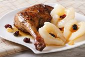 Roasted Duck Leg With Pears  Closeup On A White Plate.