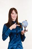 Young Girl Pointing At Globe