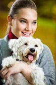 Portrait of girl with her adorable dog