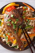 Duck Leg With Rice Noodles And Vegetables  Close-up. Top View