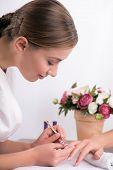 client and manicurist in manicure salon