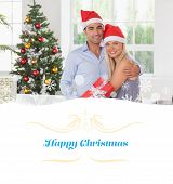 Happy couple at christmas against Christmas greeting card
