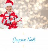 festive woman holding gifts against Christmas greeting card