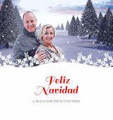 mature winter couple against feliz navidad