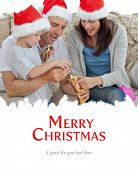 Happy parents with thir opening crackers together against merry christmas