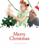 Cute little girl decorating the christmas tree with her father against merry christmas