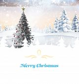 Composite image of christmas card against christmas tree in snowy landscape