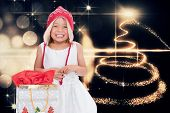 Cute girl at christmas against christmas light design