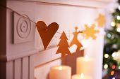 Christmas garland near fireplace close-up