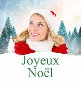 happy festive blonde against joyeux noel