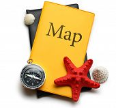 Compass, Seastar And Seashells On Map