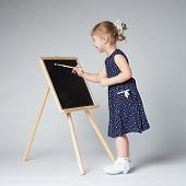 little cute girl painting