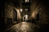 People walking at Carrer del Bisbe  in Barri Gotic, Barcelona