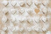 Heart-shaped Christmas cookies with powder sugar