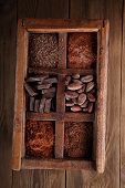 pic of wood pieces  - old spicy box full of chocolate  - JPG