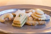 stock photo of desert christmas  - Selection of Christmas cookies on a tin plate - JPG
