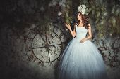 foto of mystique  - Woman with flowers on her head in the fairy forest behind her big clock - JPG