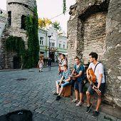 Street Musicians At The Evening Near Famous Viru Gate In Old Town Tallinn