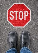 Text on the floor - Stop Sign