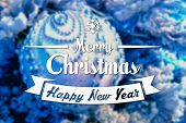 foto of blue spruce  - Merry Christmas and New Year greeting card on blurred festive decoration ball or toy and spruce blue colored background - JPG