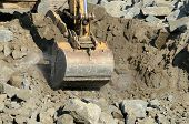 image of excavator  - Tracked excavator or track hoe digging at a large construction site removing a hill - JPG