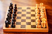 Vintage Chess Standing On Ancient Wooden Chessboard