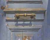 old worn door and bronze handle detail