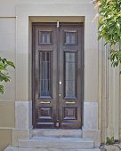 entrance with solid wood door Athens Greece