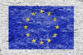Flag Of European Union Over White Brick Wall