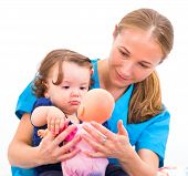 stock photo of babysitter  - Photo of an adorable baby with her babysitter - JPG