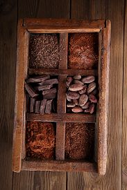 stock photo of grating  - old spicy box full of chocolate  - JPG