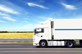 foto of moving van  - truck with freight moving fast on road - JPG