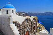 stock photo of canopy roof  - Traditional Greek blue dome Church in Oia Santorini Greece - JPG