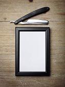stock photo of razor  - Vintage straight razor blade and blank canvas - JPG