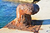 picture of bollard  - Old rusty mooring bollard on port of Hvar Croatia - JPG