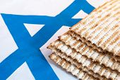 pic of passover  - Traditional unleavened bread for Passover on the background with the Star of David - JPG