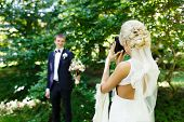 picture of shoot out  - Bride shooting of her fiance in a park - JPG