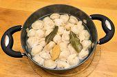 picture of boil  - russian boiled pelmeni boiling on the pot - JPG