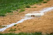 stock photo of baseball bat  - Baseball base on a youth league baseball field - JPG