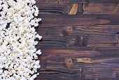 foto of popcorn  - Freshly made popcorn on a wooden table - JPG