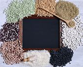 foto of legume  - Legumes on wooden table in the kitchen - JPG