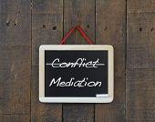 foto of blackboard  - Blackboard old wooden with word conflict and mediation - JPG