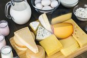 pic of cheese platter  - Assorted cheese on wooden cutting board Dairy products selection - JPG