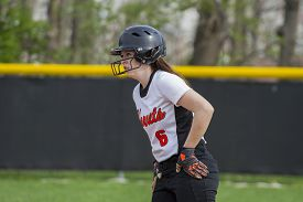 picture of fastpitch  - A female fastpitch softball player watching for the coaches signals - JPG
