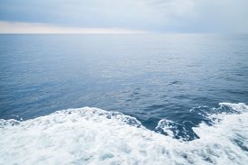 foto of sailing vessels  - Boat bow sailing in blue Mediterranean sea in summer vacation - JPG