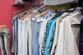 picture of mahi  - Many dresses on raks at clothes shop - JPG